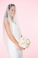 Portrait of a bride holding a bouquet