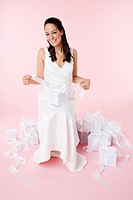 Bride sitting with wedding gifts