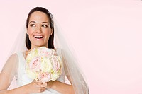 Smiling bride holding a bouquet