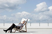 woman relaxing in deck chair