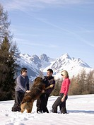 friends laughing with dog on mountain