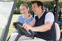 Couple driving a golf cart (thumbnail)