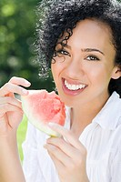 Young woman with slice of watermelon