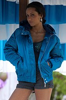 Young woman in blue blouson