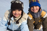 Cute girl and boy winter portrait