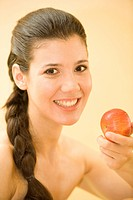 Portrait, woman eating apple