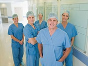Team of surgeons in hospital corridor