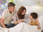 Mother and father visiting son in hospital