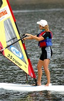woman learning windsurfing