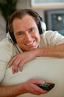man listening music headphones