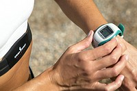 woman with pulse watch jogging
