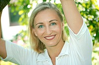 Blond woman in the garden, portrait