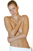 nude young woman wrapped in a towel