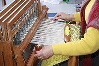 An azorean craftswoman weaving with a traditional loom  Sao Miguel island, Azores islands, Portugal