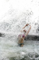 Thailand, thai woman refresh on waterfall at Thale Ban National Park