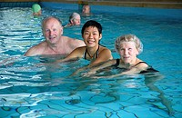 Retired German couple with their Chinese daughter in law in a public swimming pool