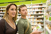 Couple shopping together at supermarket