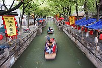 Boats taking tourists along canal, Tongli, Jiangsu, China, Asia