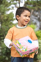 Young boy smiling and holding his Easter agg box, South Africa