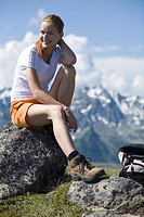 Young pretty woman having rest in the mountains