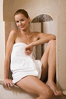 Young woman relaxing in steam sauna