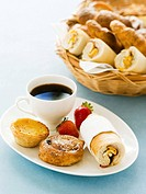 Pastries and bread rolls with coffee
