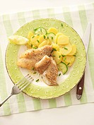 Fried fish fillets with potato salad overhead view