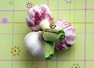 Three fresh garlic bulbs