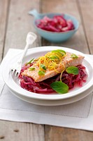 Salmon trout with lemon and mint on red onions
