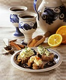 Mulled wine in jug & cups with wholemeal bread & herb butter