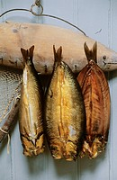 Smoked fish hanging on a board
