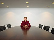 Businesswoman sitting in conference room portrait