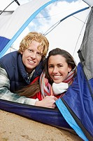 Young Couple Lying Down in Tent.