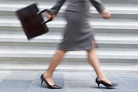 Businesswoman walking quickly low section
