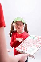 Girl in green sun visor showing pizza box