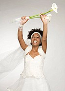 Black Latin Bride with wavy hair plays with a bouquet