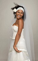 Black Latin Bride in her 20s smiles happily