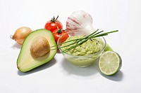 A dish of guacamole with ingredients
