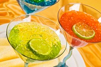 Green, Red and Blue Martinis with Ice and Lime Slices