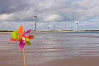 Windmills and pinwheel on shore