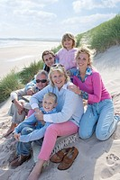 Portrait of multi_generation family sitting on beach