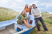 Young family sitting in boat