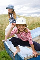 Portrait of young girls standing on boat