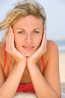 Portrait of young woman relaxing at beach, close_up
