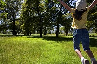 Girl jumping in field (thumbnail)