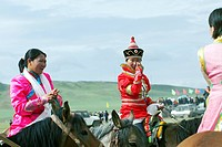 Mongolian women in traditional costume riding horse, Nalati Grassland, Ili Kazakh Autonomous Prefecture, Xinjiang Uyghur Autonomous Region, China