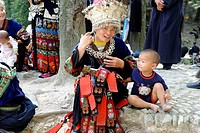 A Miao woman sitting with her son, Nanhua, Kaili, Qiandongnan Miao and Dong Autonomous Prefecture, Guizhou Province, China