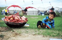 Mongolian girl sitting beside a basin full of raw lamb, Xilin Gol Grassland, Inner Mongolia Autonomous Region, China