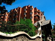 Residential buildings in Sarria, Barcelona, designed by Jose Antonio Coderch Sentmenat, next to a fence works of Antonio Gaudi, at Manuel Girona
