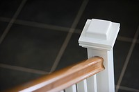 Detail newel post at bottom of staircase railing